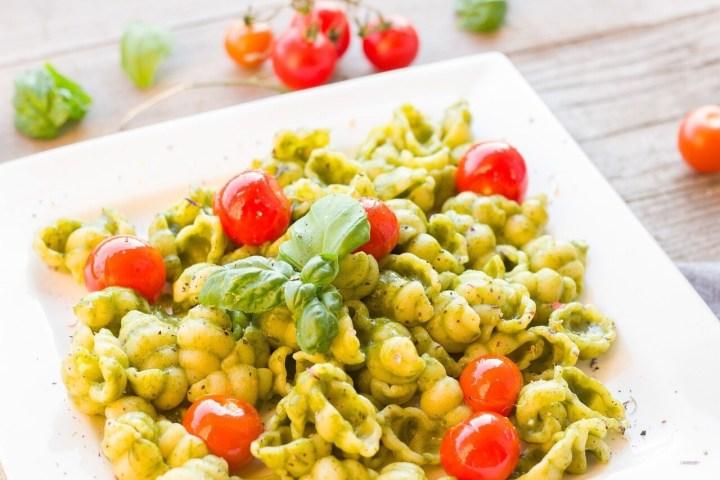 Riccoli pasta with pesto and cherry tomatoes