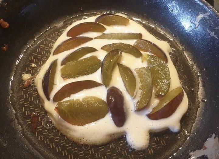 Plum pancake preparation, baking in pan