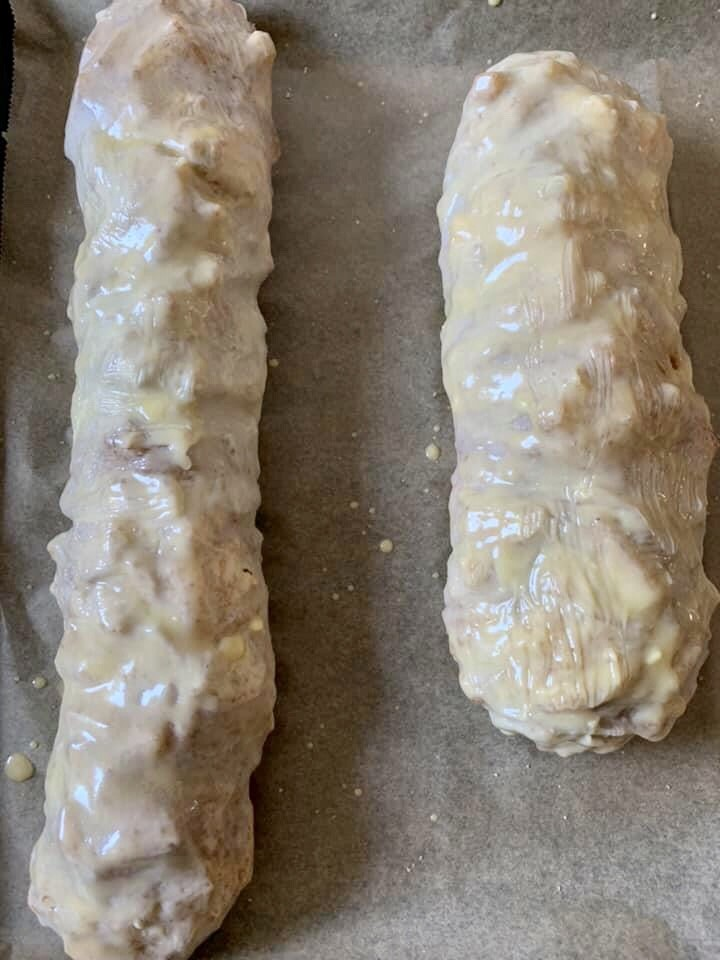Brush Apfelstrudel with melted butter and egg yolk