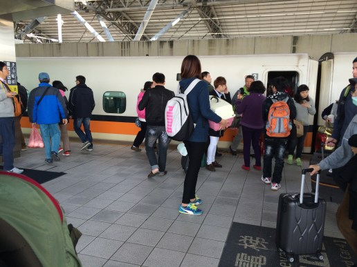 People trying to get onto the bullet train.