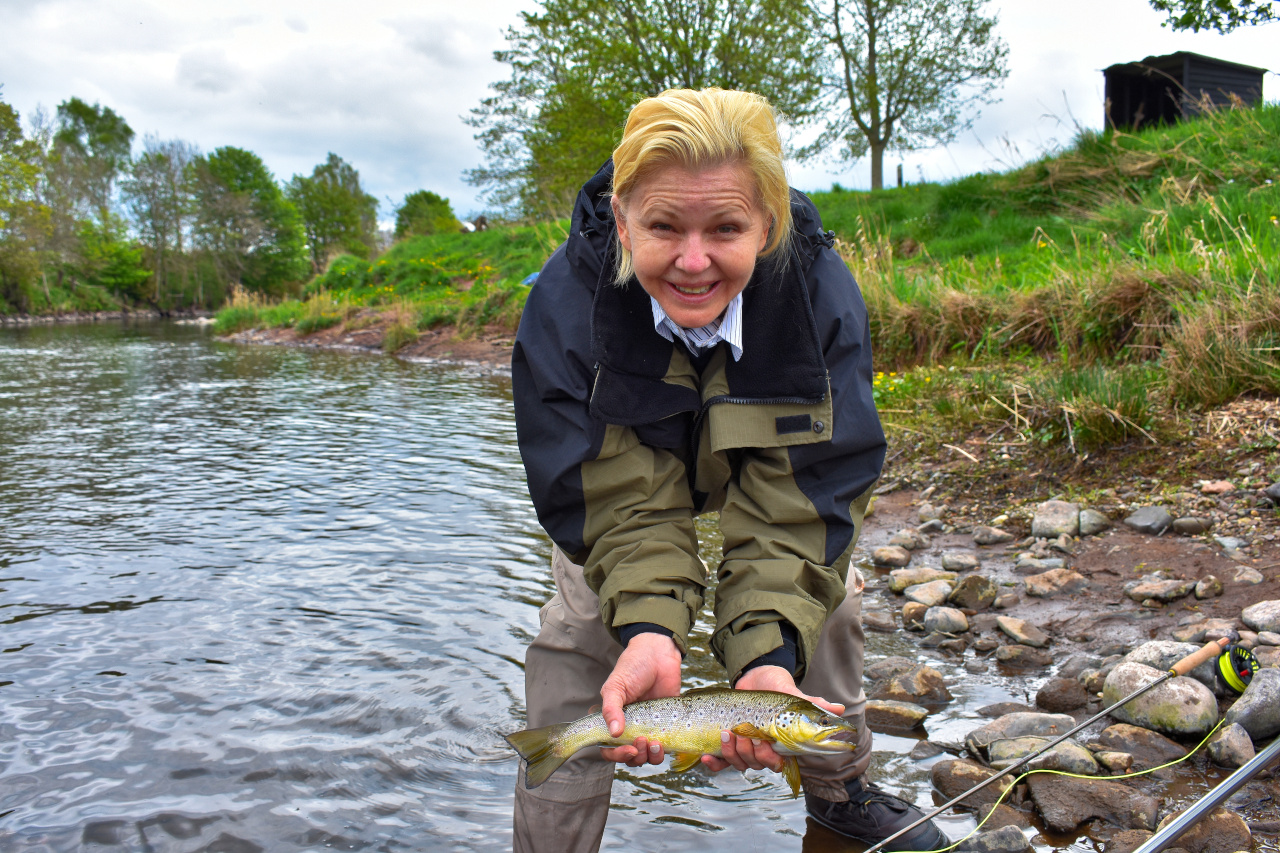 client with brown trout caught while on a fly fishing trip
