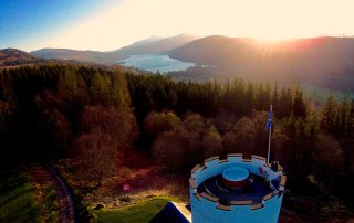 view from above of scottish hills and lochs