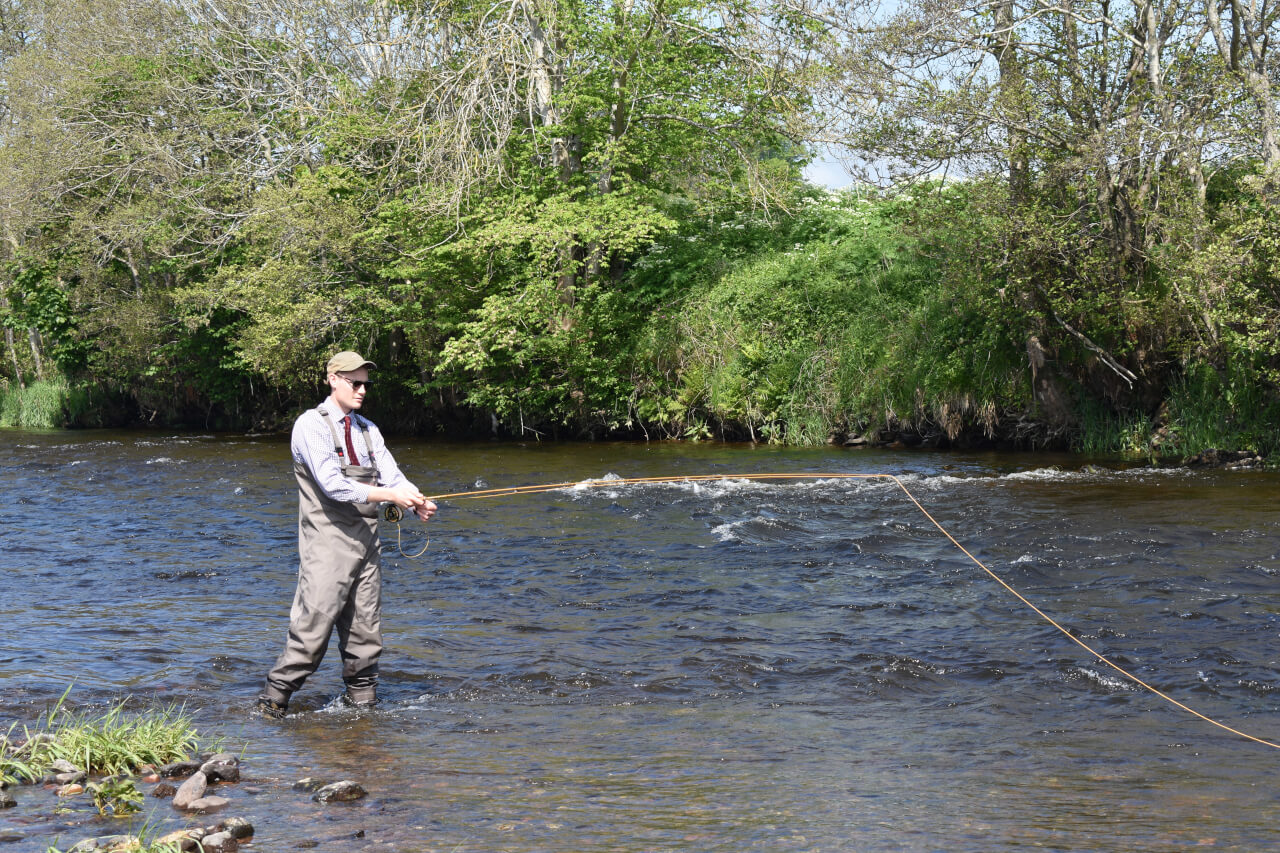 learning fly casting during guided trout fishing trip in scotland