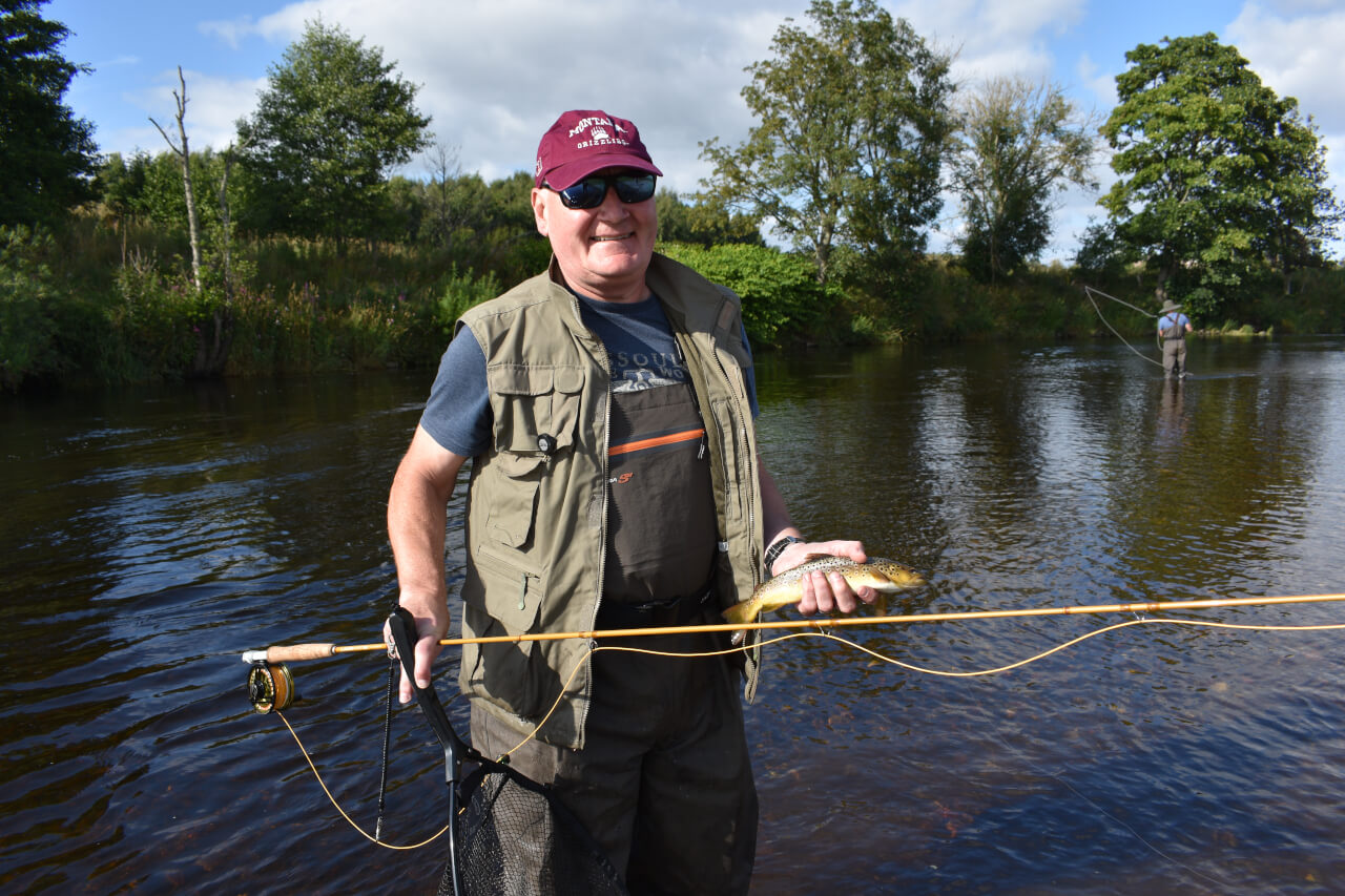 brown trout caught on guided fishing day on river