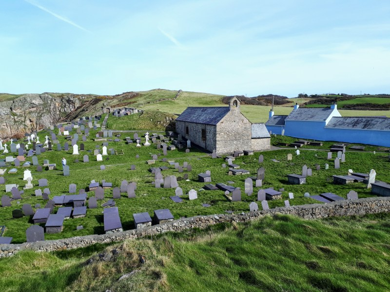 A picture of Llanbadrig Church and Cemetery taken from a small hill overlooking the grounds