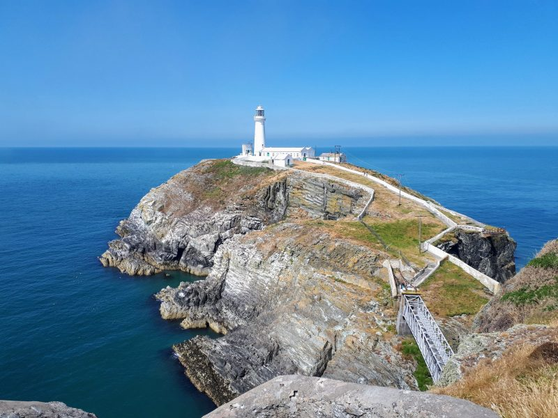 An image of South Stack lighthouse from the cliffs opposite