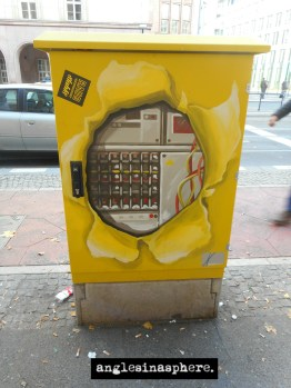 not sure if this was done intentionally or someone cleverly painted on these (I assume) electrical boxes
