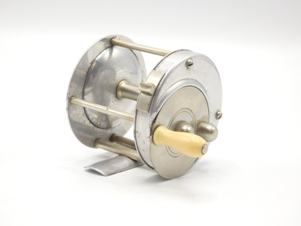 """alloy construction 2 ¼"""" diameter reel with off-set nickel silver circular drive plate having counter-balanced baluster ivorine handle and domed locking screw, 4:1 ratio retrieve, twin nickel silver pillared bridge foot, triple nickel silver drum pillars, rim mounted sliding spool release/casting lever, rear mounted optional check button and milled spindle cap, backplate point engraved """"Redifor"""" and script engraved """"Warren , Ohio, USA"""" along the lower rim, the reel is in very good overall condition and dates from the company's inception of 1904, see further detail below (see illustration) £2000-3000 ** Graham Turner covers in great depth the potential of Coggeshall's Redifor reel being the first model reel of this style having been produced by the company circa 1904, see: https://anglingauctions.com/coggeshall.pdf for his full explanation. Certainly, Coggeshall was known to have forwarded R.B. Marston, Editor of The Fishing Gazette a circular of a Redifor made bait casting reel which appeared in the Gazette on 12th November 1904 with Marston stating """"The other day Mr. W.D. Coggeshall of the Fly Fisher's Club sent me an illustrated circular describing a new American reel in which, although it is a multiplier, has done away with the outside crank-handle"""" This fact indicates the WDC reel pre-dates the earliest advertised """"B"""" models available in 1905. Included with the lot is a binder compiled by Graham Turner which details the provenance of the Redifor reel along with a hard copy of the ORCA magazine containing GT's article on the Coggeshall collection"""