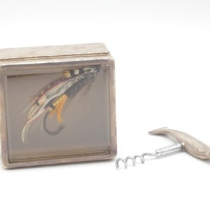 A silver corkscrew in the form of a salmon