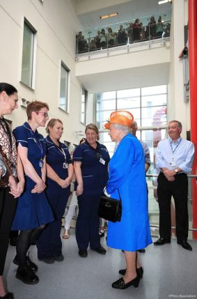Her Majesty visits with and commends the staff of Royal Manchester Children's Hospital.