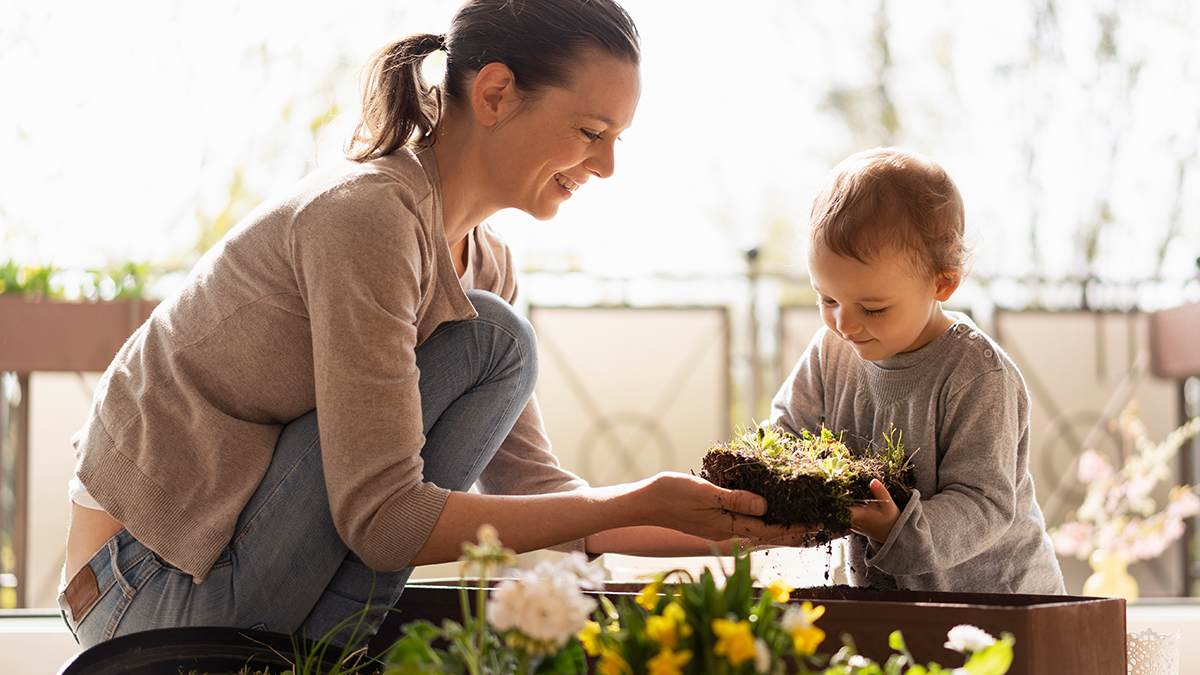Mother and young son gardening