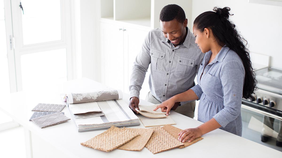 couple looking at renovation samples