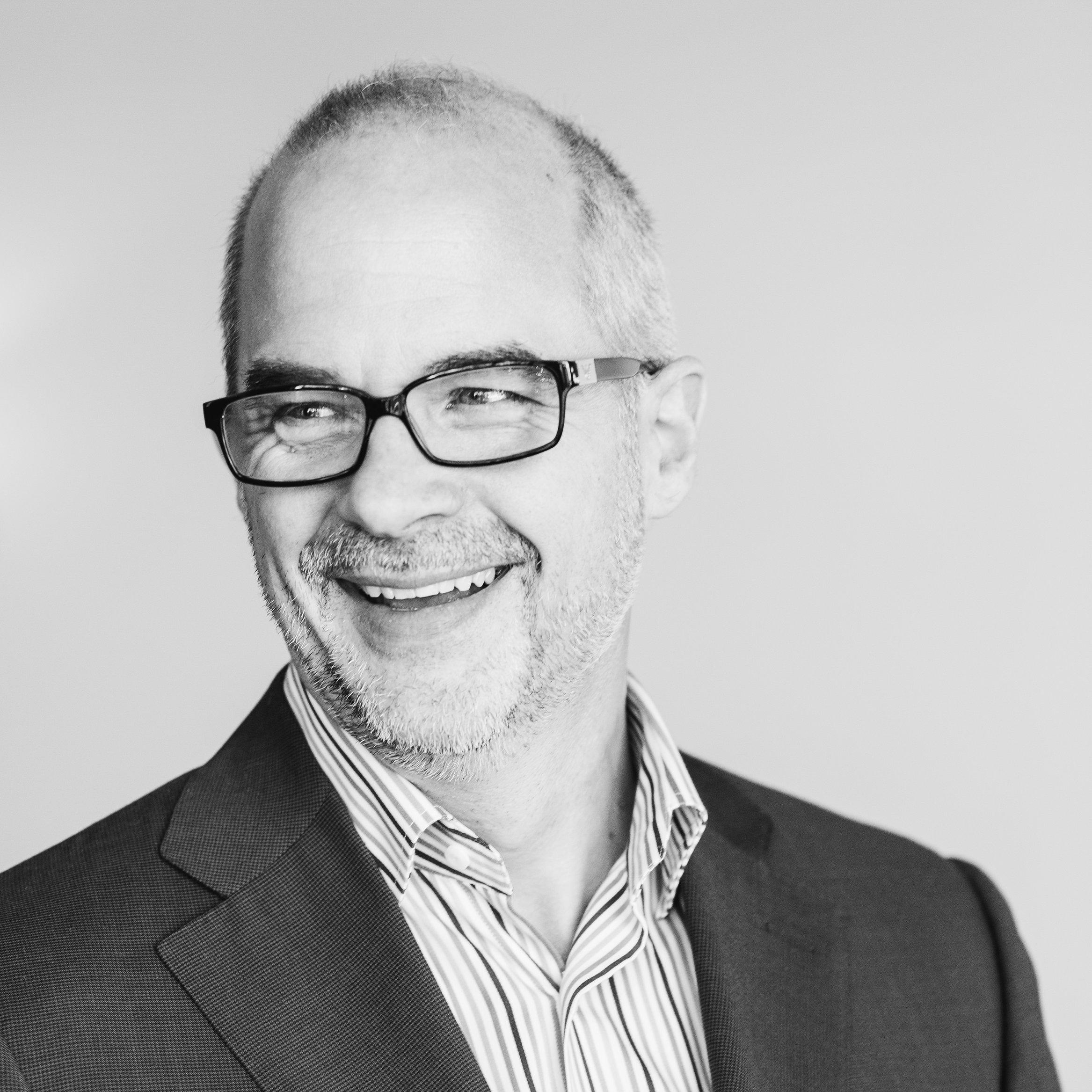 Black and white headshot photo of Jeff Shore, speaker