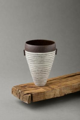 stripy black and white vessel