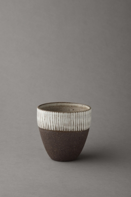 stripy black and white vessel