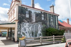 Large mural of waterfall on wall of Restaurant-Cafe