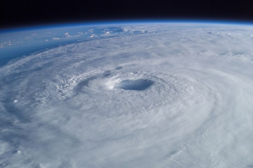 The storm may swirl, but a calm eye remains at the center. (Image courtesy of Wikipedia.)
