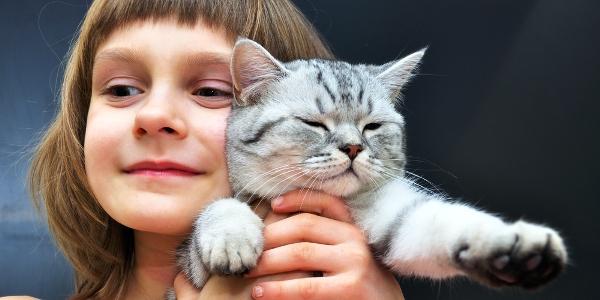 Child Holding Cat