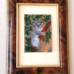 Miniature painitng with a koala hugging a tree