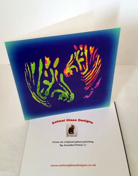 Colourful card with two multi-coloured zebras