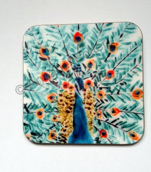 A peacock coaster featuring the birds feathers displayed behind him