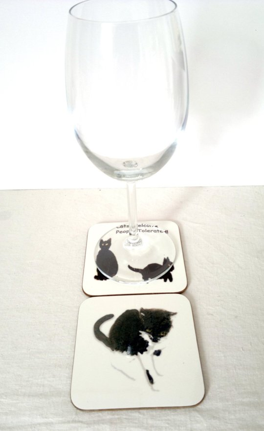 A black cat coaster set photo with wine glass