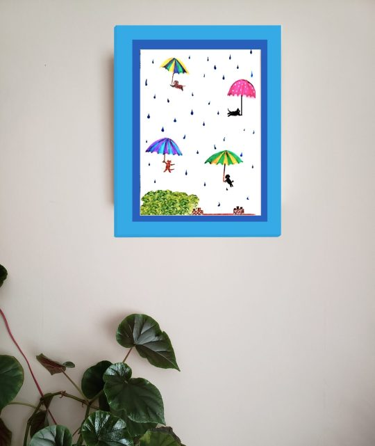 Wall art with a fun A4 print of cats, dogs and umbrellas in the sky with raindrops