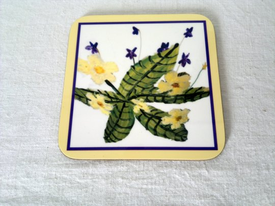 Floral drinks coaster with violets and primroses
