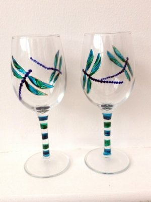 A pair of dragonfly wine glasses, hand painted