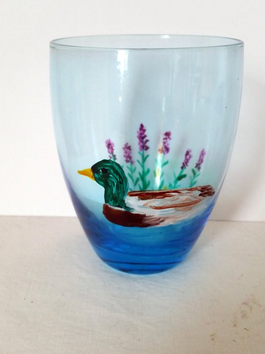 Duck glass painting on a blue glass