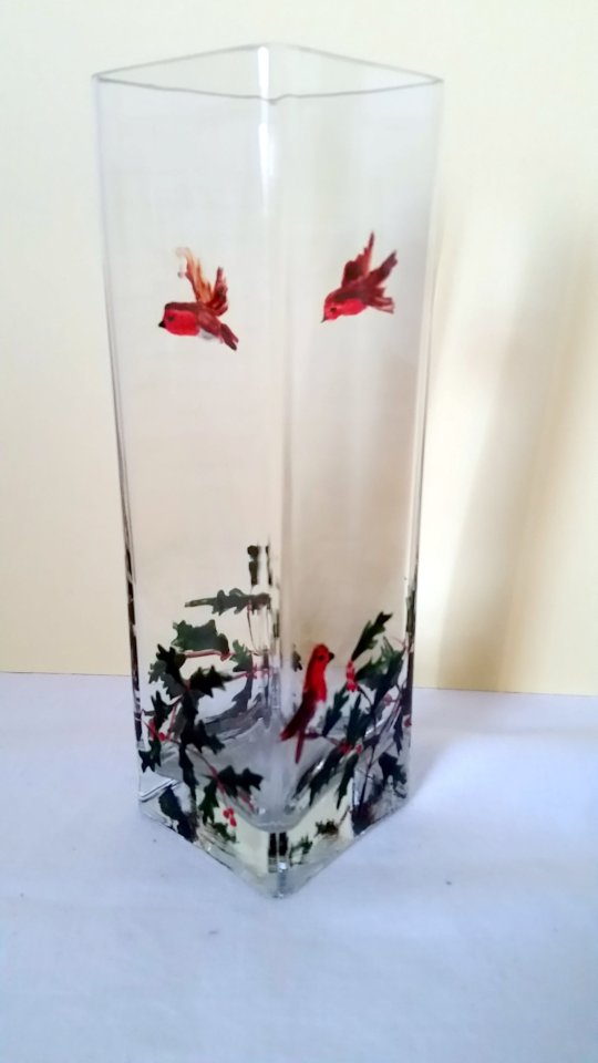 A festive square glass vase hand painted with holly and robins