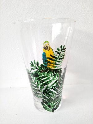 Parrot and fern glass painting photographed foliage side