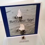 Funny card with two swans heads down in the water and the text 'Bottoms Up!'