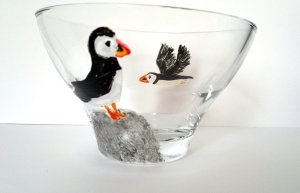 Hand painted glass bowl with a puffin in flight and a puffin on a rock