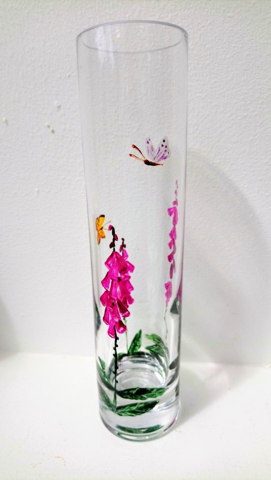 Glass bud vase painted with foxgloves and two butterflies