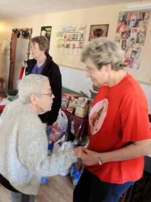 Chris Smith, left, talks with old friend Inge Edwards during Sunday's open house and Christmas party at the Animal Refuge Center in Vine Grove. -- Photo by Neal Cardin