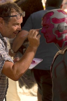 Jeremy Woodhead touches up Paul Bettany as Vision | Photo by Jay Maidment © 2014 MVLFFLLC. TM & © 2014 Marvel. All Rights Reserved.