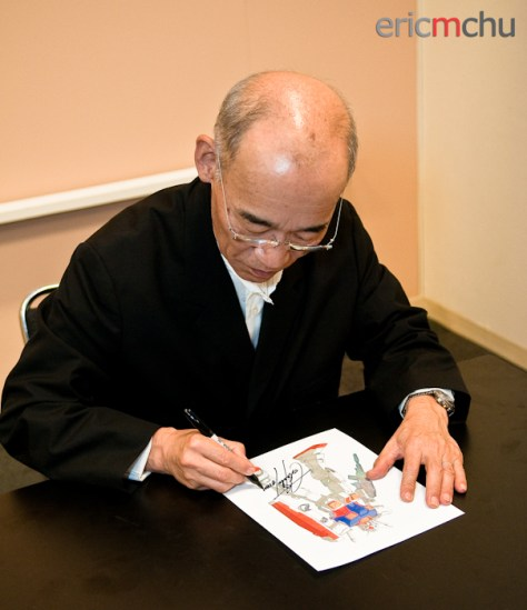 Tomino signing a sketch of the R78 Gundam. Photography by Eric M Chu.