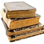 stack-of-old-books-against-white-background1