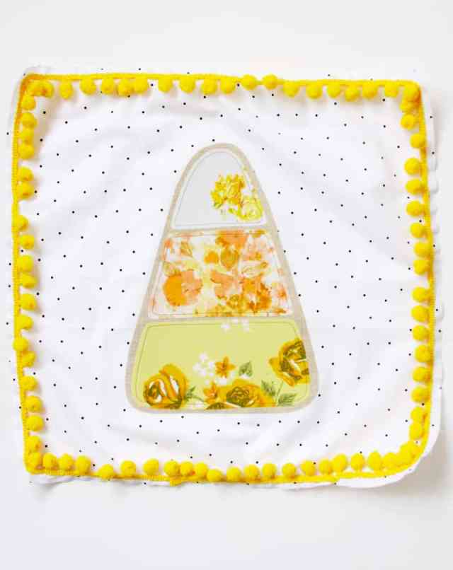 pom-pom-trim-on-candy-corn-pillow