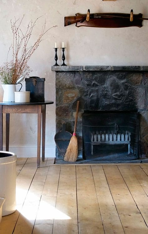 Image above: This rustic and timeless hearth could be in the home of any number of witches throughout history. We love the rich and imposing stone used for the fireplace.