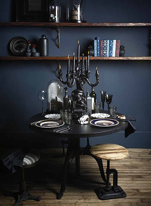 Image above: Michelle's Thanksgiving tablescape is perfect for an All-Hallow's Eve dinner as well. We love love LOVE how the lacquered candelabra sets the scene for the entire look. Further proof that one small tweak can have big impact.