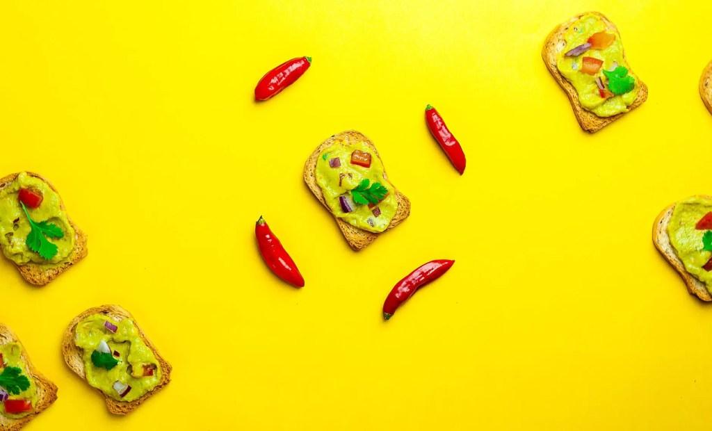 tasty mexican guacamole on slice of bread
