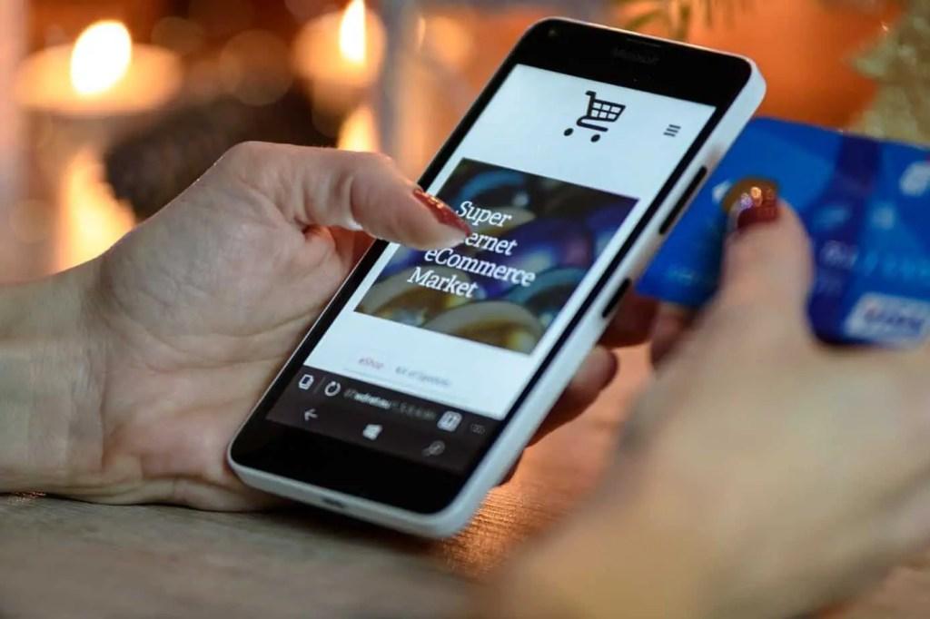 Man holding Iphone making online order
