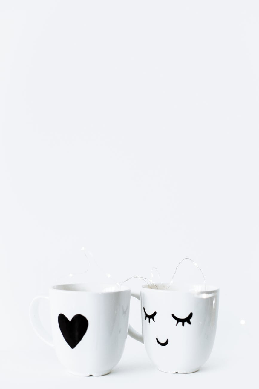 creative white mugs on white surface