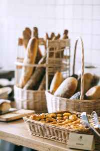 delicious baked bread and buns in baskets