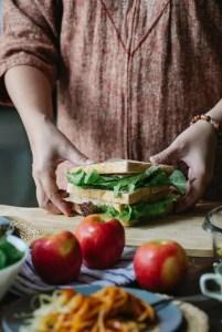 crop faceless woman preparing healthy sandwich