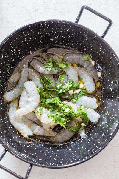 raw shrimp in a black pan for shrimp pasta