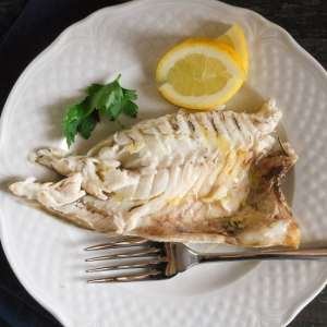 Baked whole gilt head seabream or trout