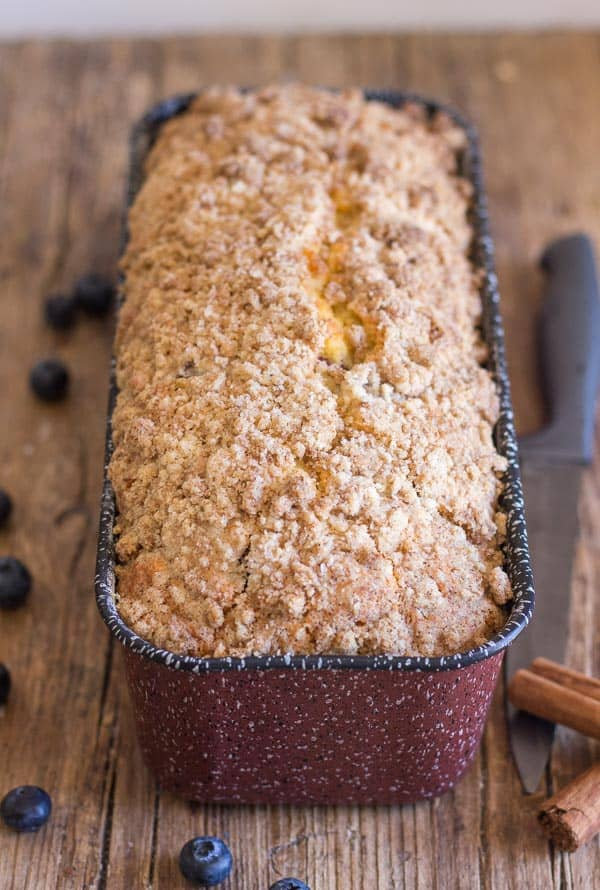 just baked in a red loaf pan blueberry streusel loaf